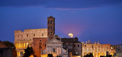The Full Moon rises behind the Colosseum