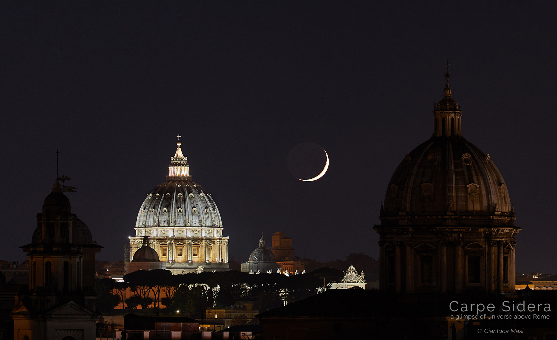 A sharp Moon crescent sets behind St. Peter's Dome in Rome