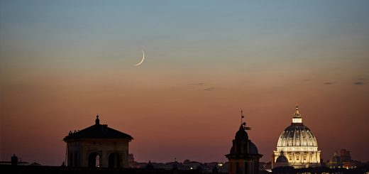 A sharp Moon crescent and planet Mercury hang above Rome at sunset