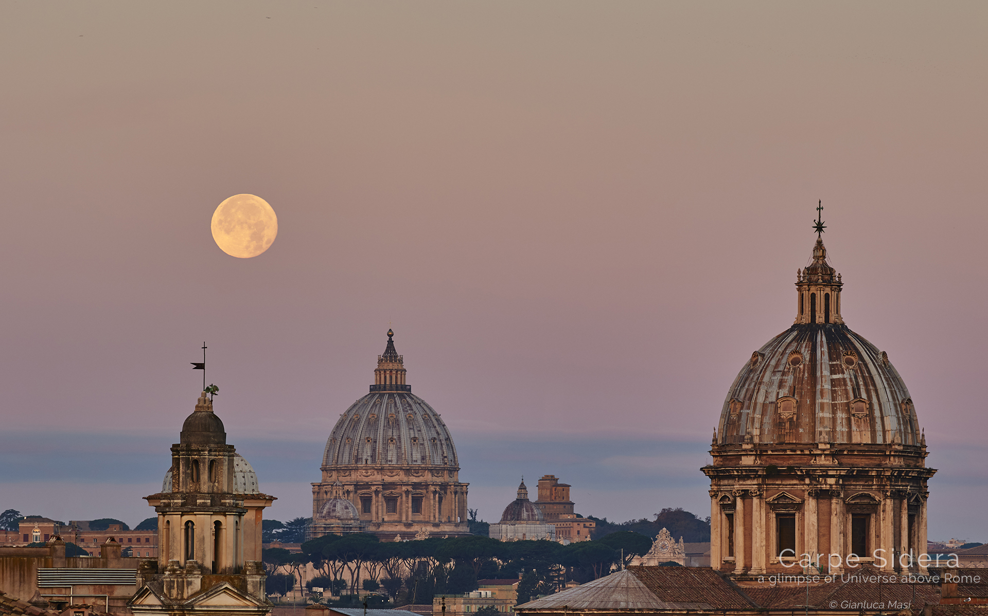 The Supermoon sets beside St. Peter's Dome, at dawn