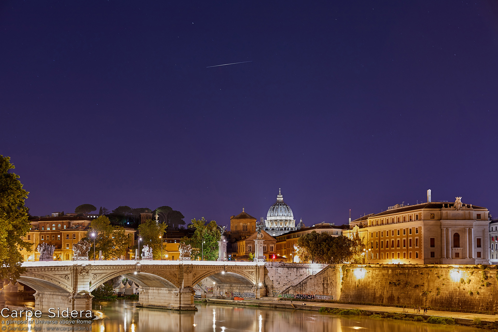 11. The Iridium 10 satellite shines above the Tiber and the dome of St. Peter's.
