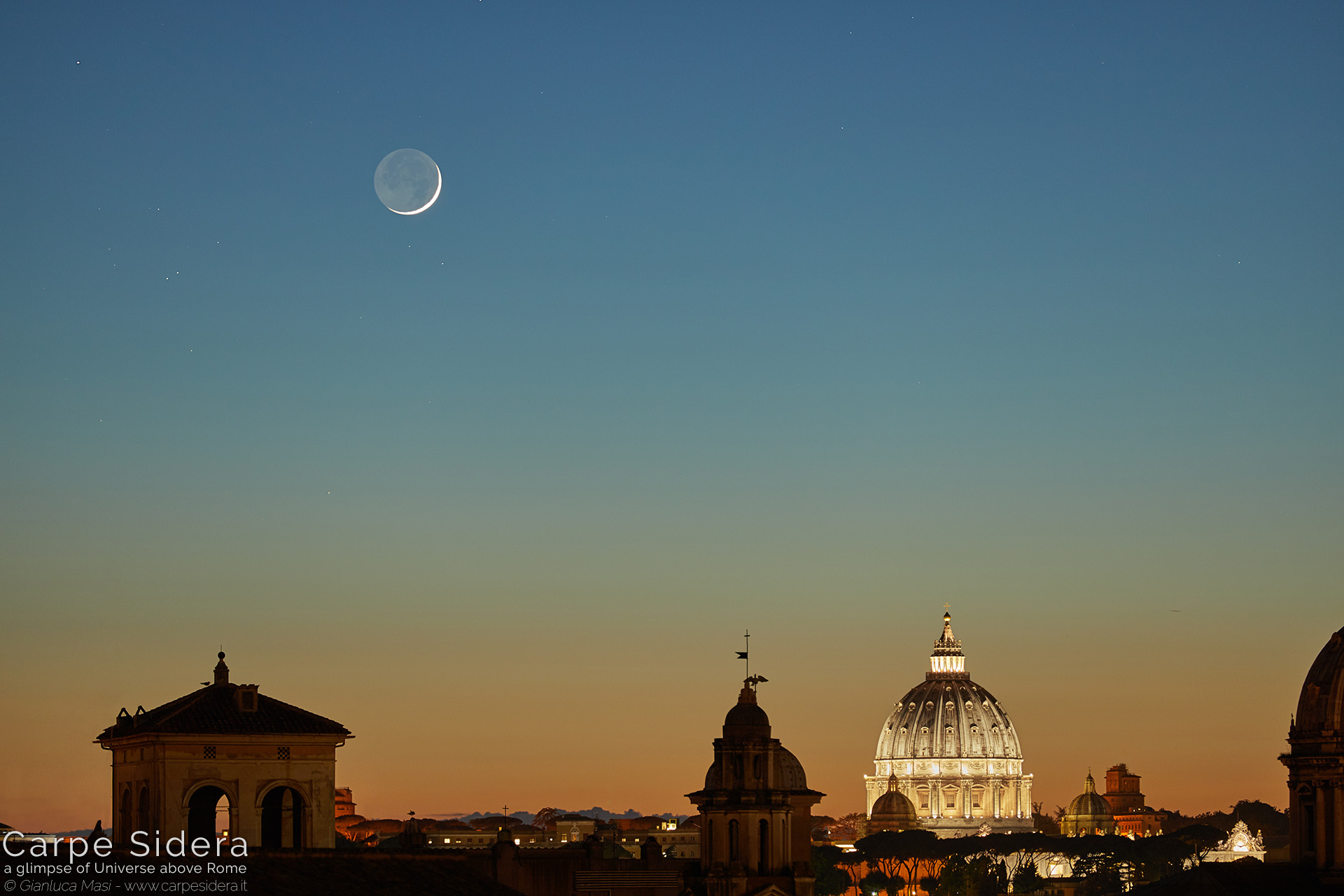 13. Moon crescent and Earthshine at sunset, above the dome of St. Peter's.