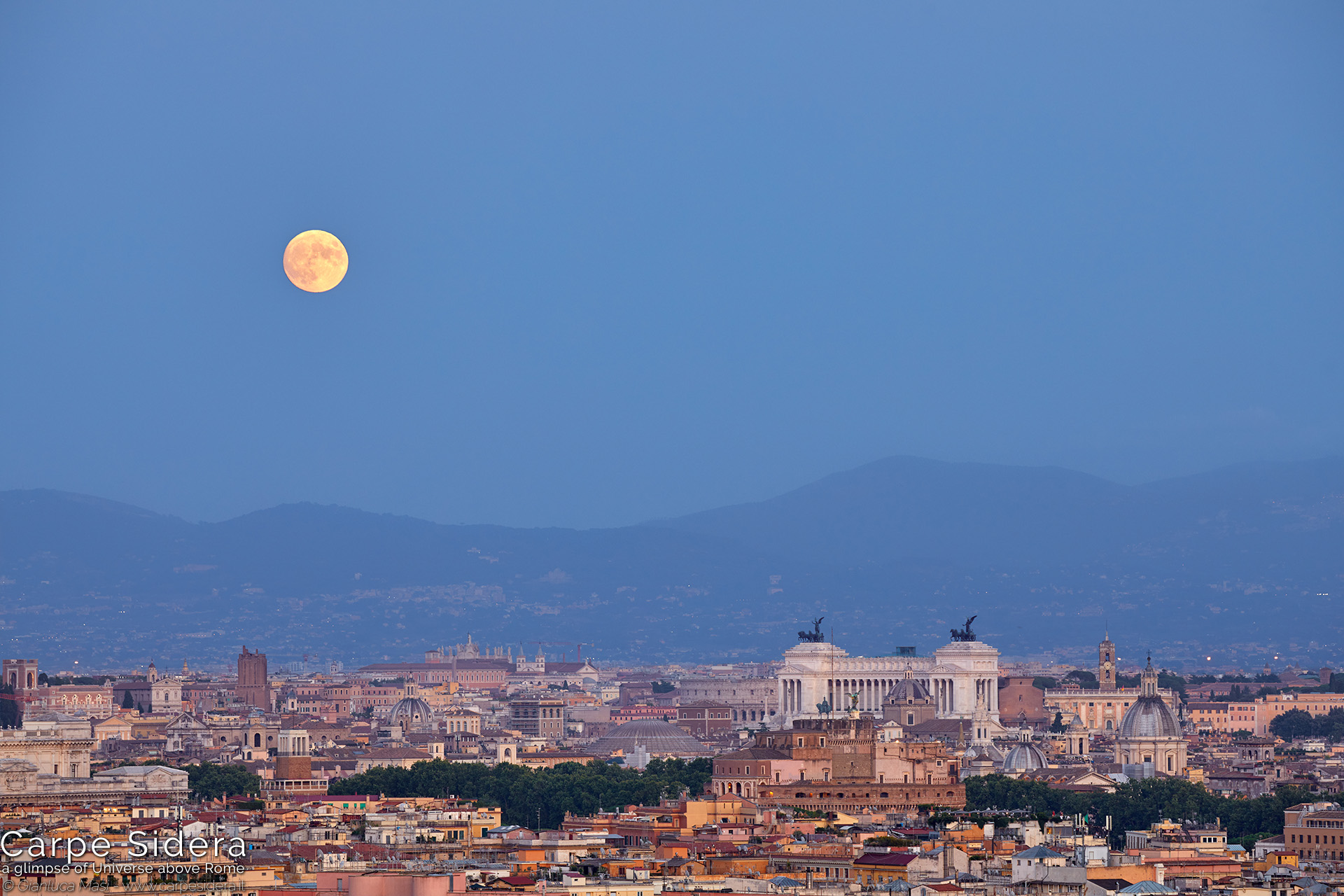 18. The summer full Moon rises above the Eternal City, at sunset.