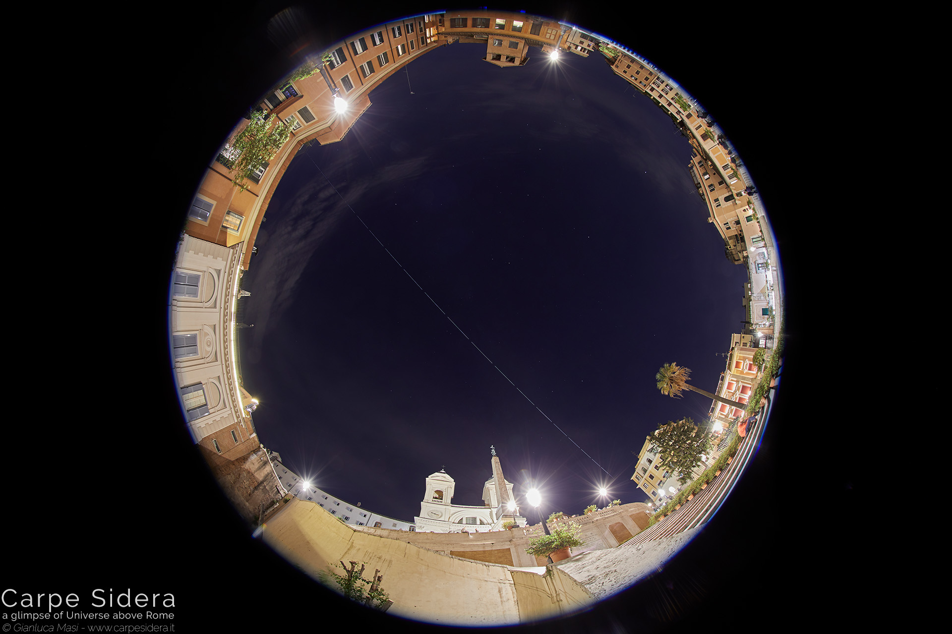 19. The International Space Station (ISS) flies above the Spanish Steps.