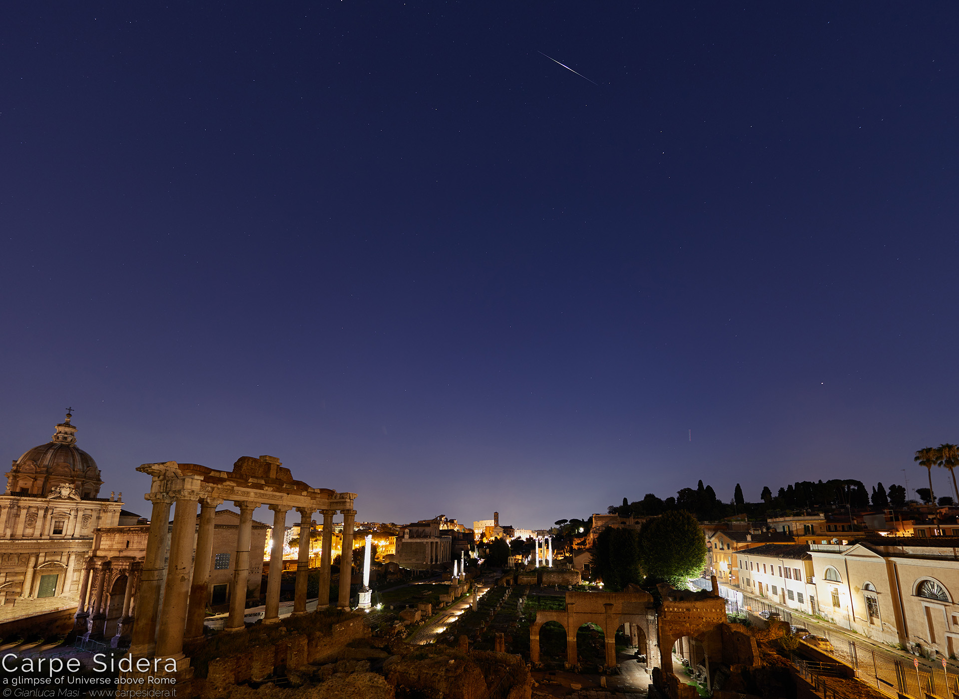 25. The Iridium 45 satellite shines above the Roman Forum.